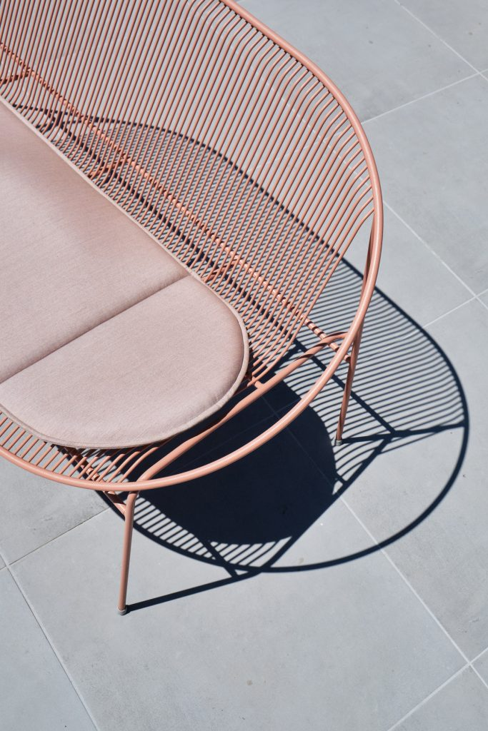 Hula loveseat on a rooftop capturing the geometric shadows of the collection. Photographed by Sean Gibson , from Marrow (Bone Interiors) Blok Penthouse project.
