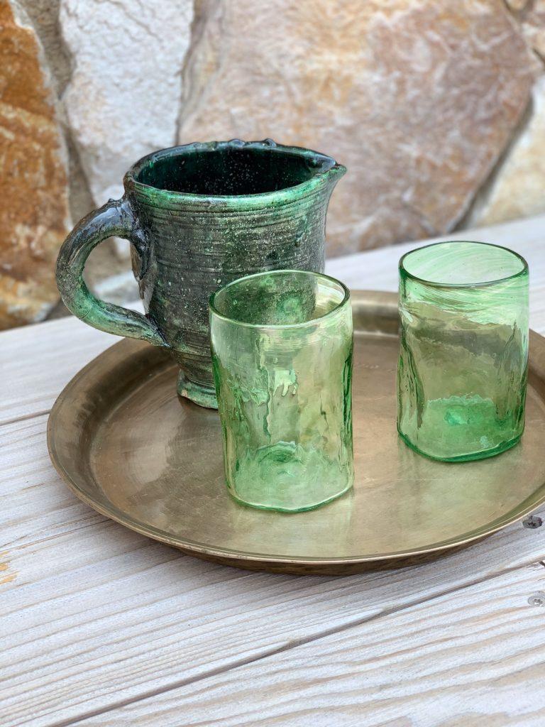 The Storer, handmade glasses, earthenware jugs, brass tray